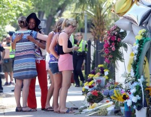 A group of women hug after praying together at a make-shift memorial on the sidewalk in front of the Emanuel AME Church, Thursday, June 18, 2015 in Charleston  (AP Photo/Stephen B. Morton)